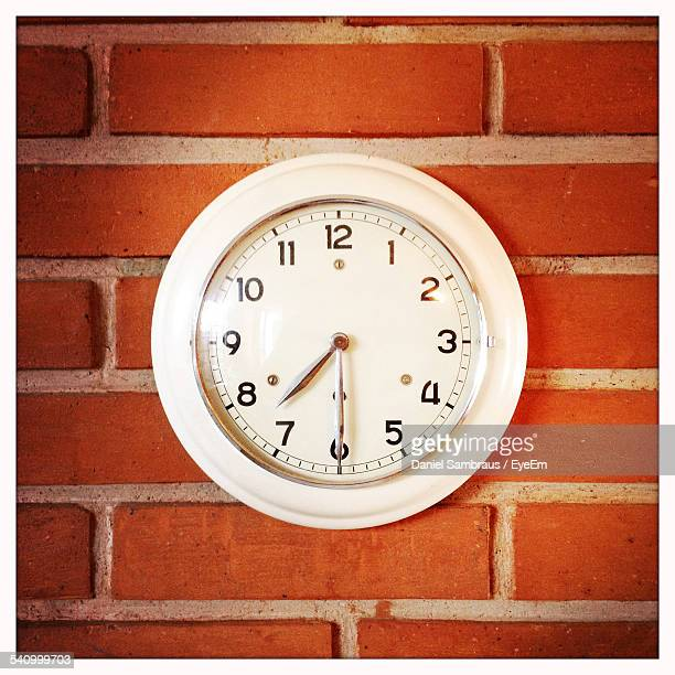 Close-Up Of Clock On Brick Wall