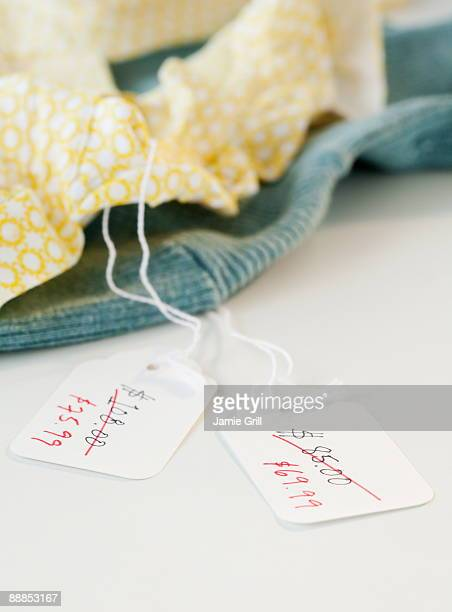 Close-up of clothing with sale tags