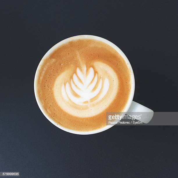 Close-Up Of Coffee Against Gray Background
