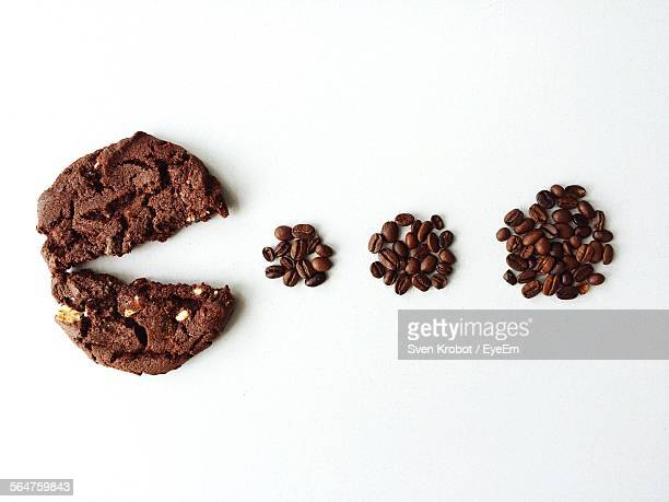 Close-Up Of Coffee Beans Over White Background