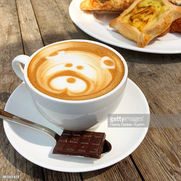 Close-Up Of Coffee Cup And Chocolate In Saucer On Table