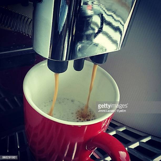 Close-Up Of Coffee Maker Pouring In Cup