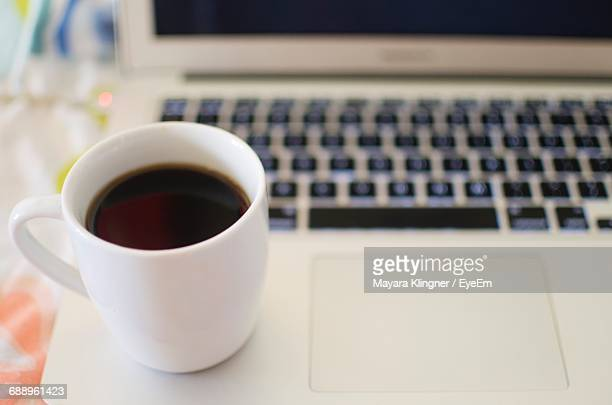 Close-Up Of Coffee On Laptop