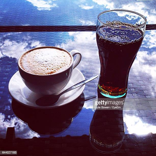 Close-Up Of Coffee Up With Cold Drink