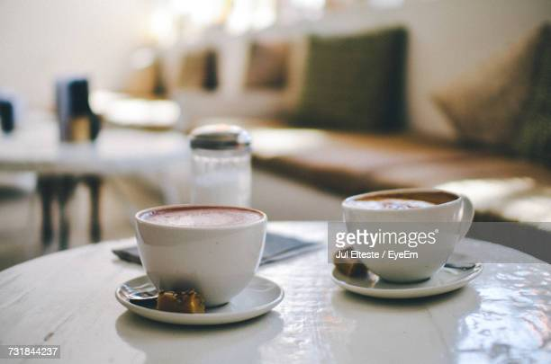 Close-Up Of Coffees Served On Table