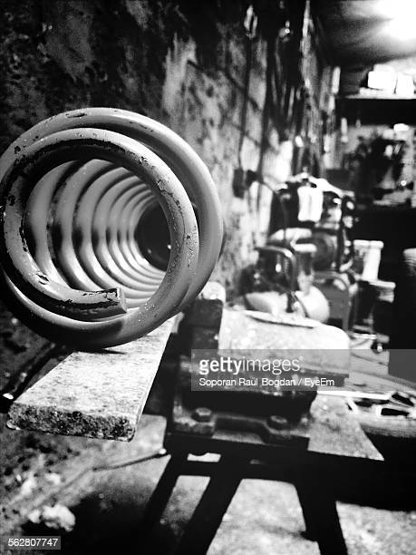 Close-Up Of Coiled Spring In Old Factory