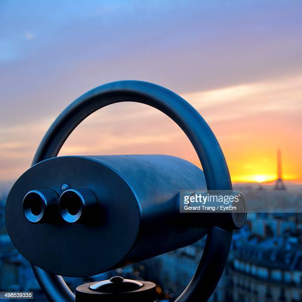 Close-up of coin operated binoculars at sunset