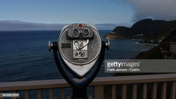 Close-Up Of Coin Operated Binoculars Facing Sea