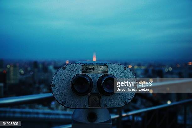 Close-Up Of Coin-Operated Binocular Against Blue Sky