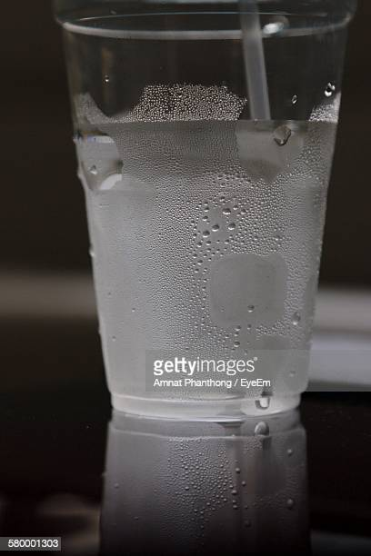Close-Up Of Cold Drinking Water In Glass On Table