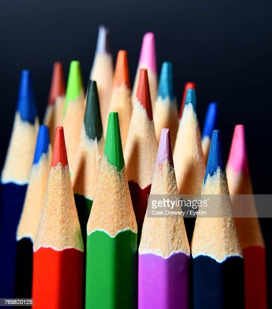 Close-Up Of Colored Pencils Against Black Background