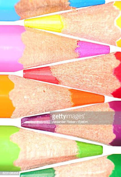 Close-Up Of Colored Pencils In Row