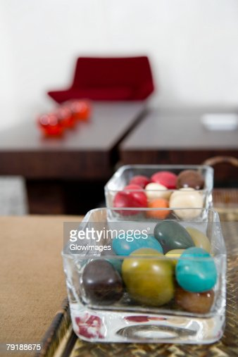 Close-up of colored stones in two bowls : Stock Photo