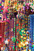 Close-up of colorful beads hanging in a New Orleans souvenier shop.