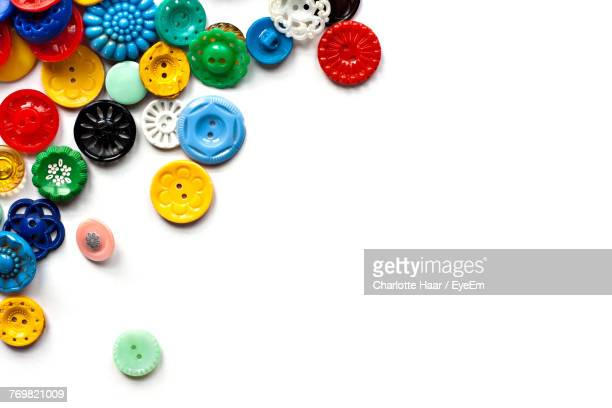 Close-Up Of Colorful Buttons Over White Background