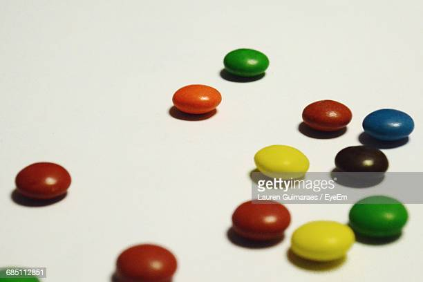 Close-Up Of Colorful Candies On White Background