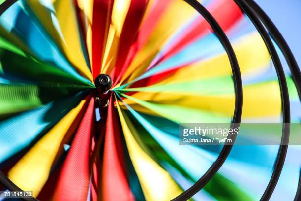 Close-Up Of Colorful Pinwheel Spinning Outdoors