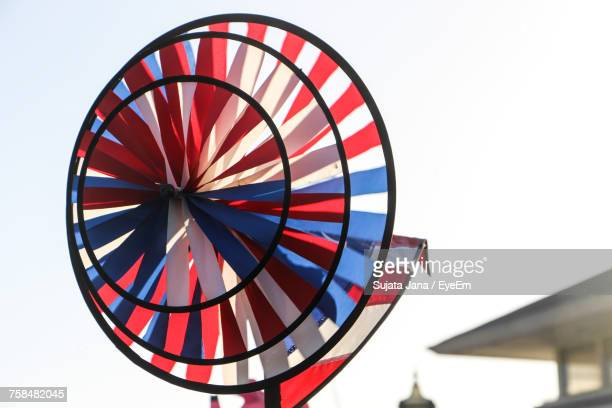 Close-Up Of Colorful Pinwheel Toy Against Clear Sky