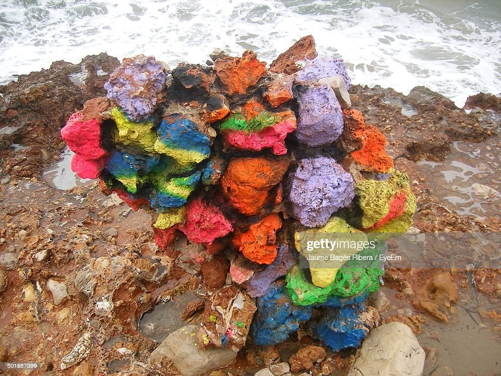 Close-up of colorful rocks on shore