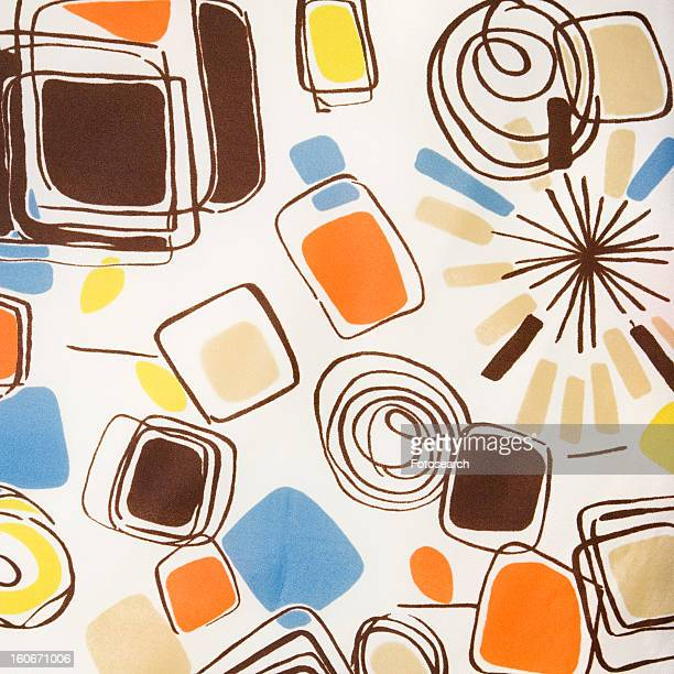Close-up of colorful vintage fabric with abstract shapes and swirls printed on polyester