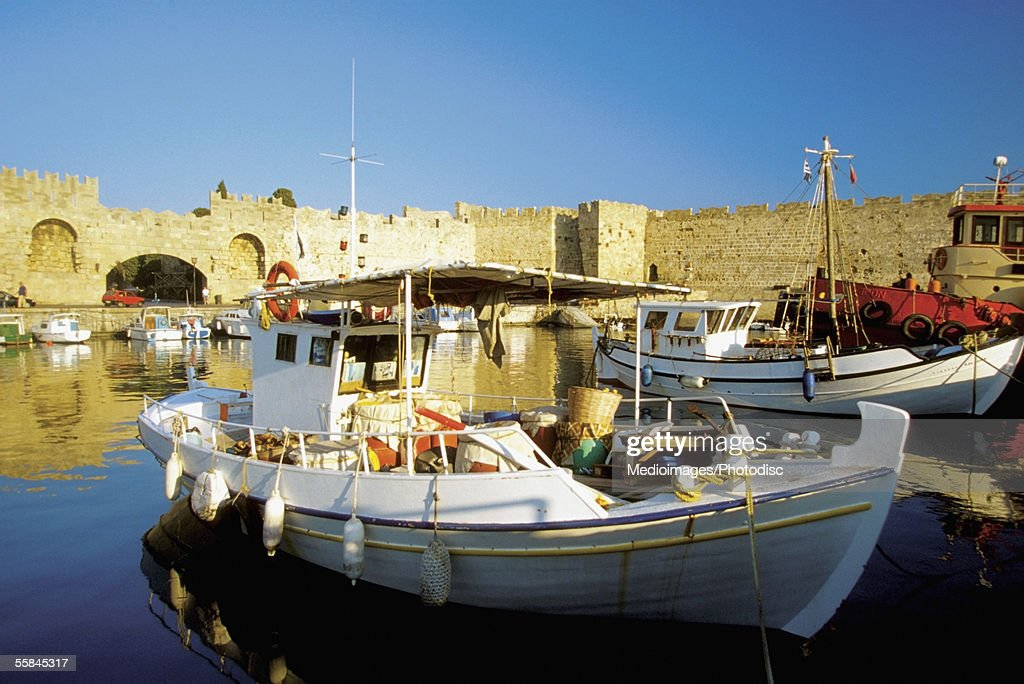 Close-up of commercial fishing boats docked at a harbor, Mandraki Harbor, Rhodes, Greece