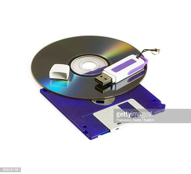 Close-Up Of Compact Disk With Usb Stick Against White Background