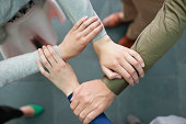 Close-up of connecting hands of business executives