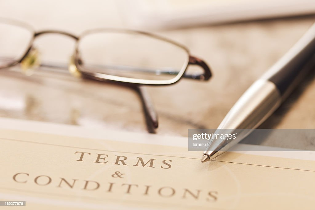 Close-up of contract with pair of glasses and pen : Stock Photo