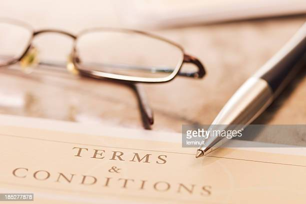 Close-up of contract with pair of glasses and pen