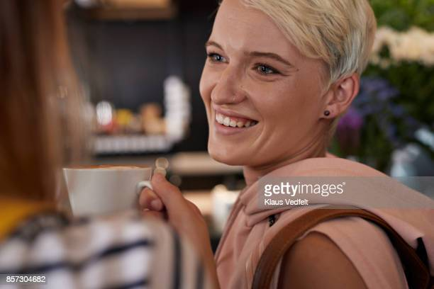 Close-up of cool young woman in café