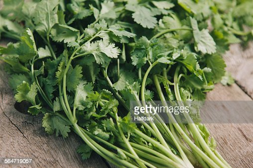 Close-up of coriander leaves on table