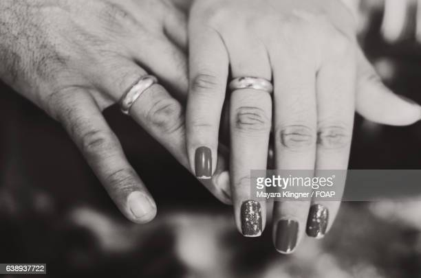 Close-up of couple hand with engagement rings