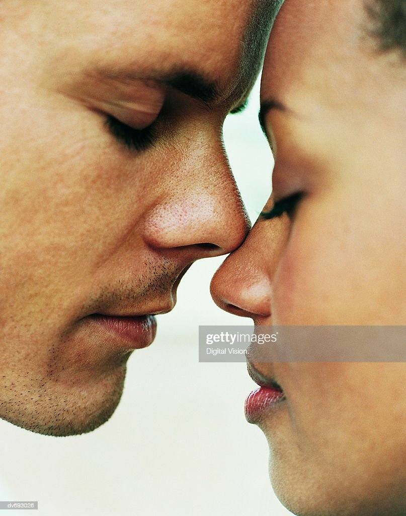 Close-Up of Couple Touching Noses : Stock Photo