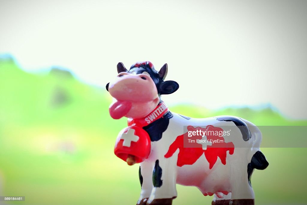 Close-up of cow toy with Swiss flag