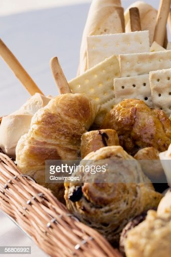 Close-up of croissant and crackers in a wicker basket : Stock Photo