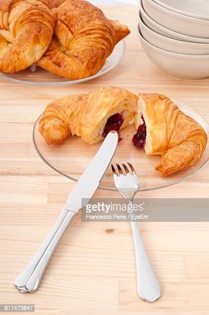 Close-Up Of Croissant Served On Table