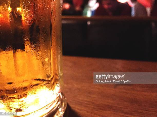 Close-Up Of Cropped Beer Glass On Table