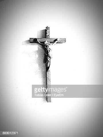 Close-Up Of Crucifix Over White Background