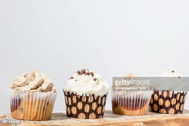 Close-up of cupcakes in front of white background
