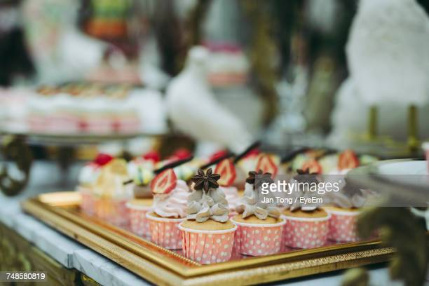 Close-Up Of Cupcakes In Tray At Store For Sale
