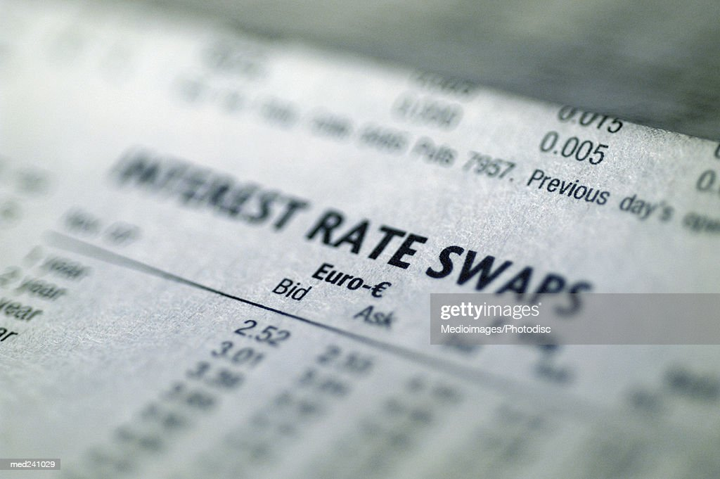 Close-up of current rates printed on paper (Blurred)
