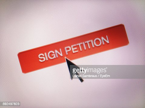 Close-Up Of Cursor On Sign Petition Icon