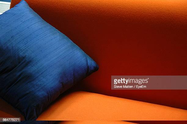 Close-Up Of Cushion On Cropped Couch
