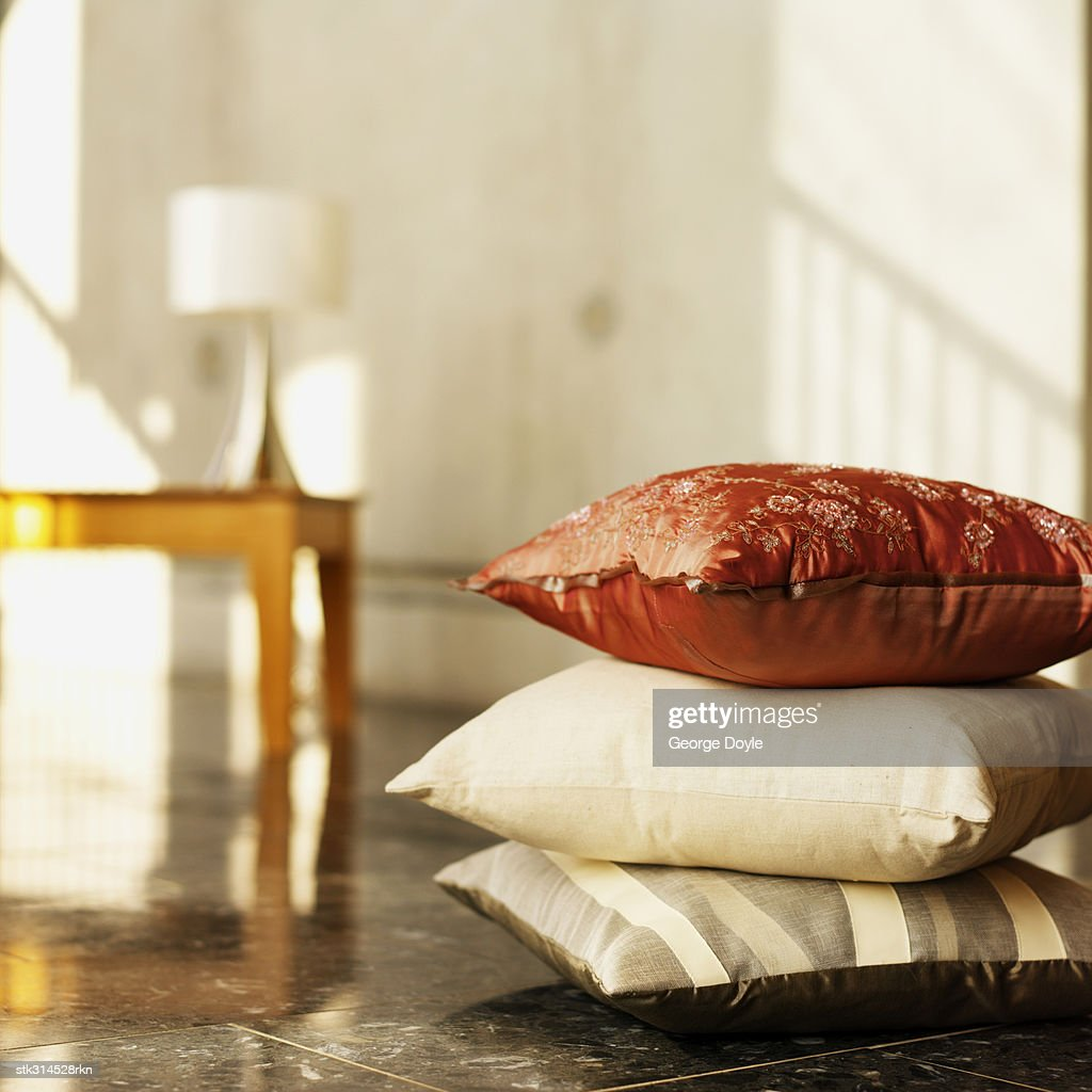 close-up of cushions stacked on the floor