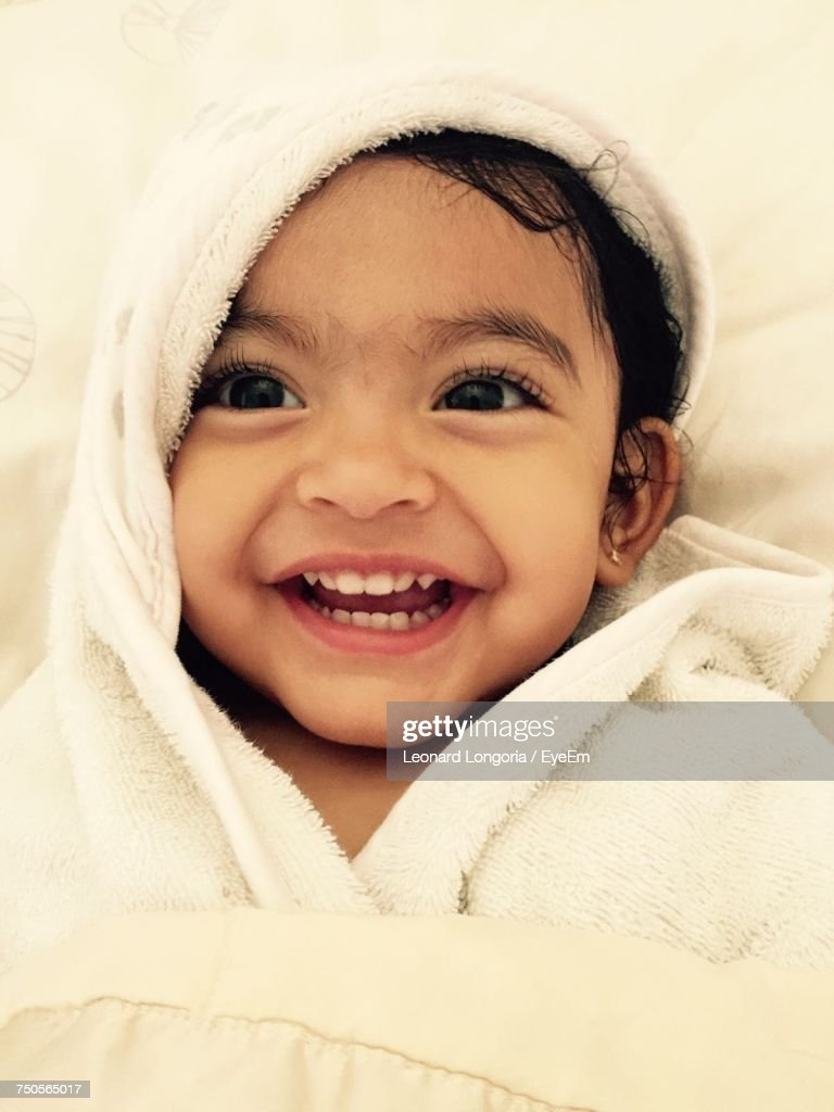 Close-Up Of Cute Baby Girl Wrapped In Towel : Stock Photo
