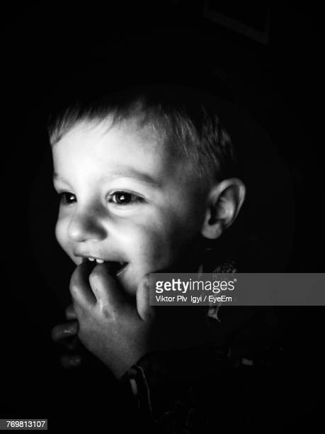 Close-Up Of Cute Boy With Finger In Mouth