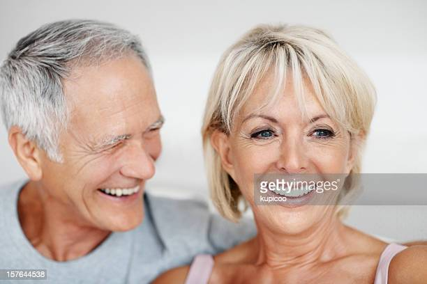 Close-up of cute senior couple having fun together at home