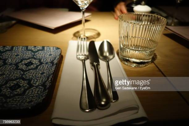 Close-Up Of Cutlery On Napkin At Table