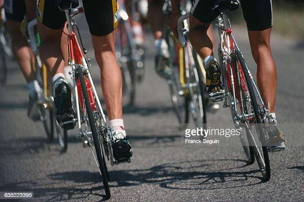 Closeup of cyclists' legs