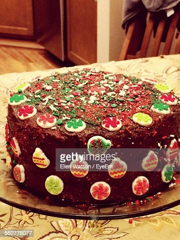 Close-Up Of Decorated Christmas Cake On Table